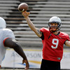 AU quarterback Mike Burel throws passes during drills Monday.