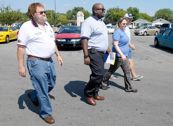 From left, Denny Cheshier, DJ Totty, Amy (Reynolds) Hale and Jim Hensley deliver a letter to management at the Pay Less on 29th Street on Wednesday.
