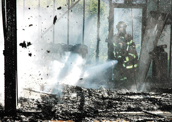 Garage fire at 2029 Pearl Street about noon Monday.