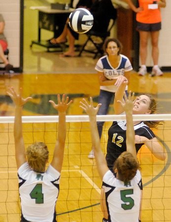 Lapel's Morgan Tarlton sends the ball over the block of Pendleton Heights' Ashlyn Wendling (4) and Carly Wilson (5) as the Arabians hosted the Bulldogs on Tuesday.