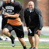 Anderson University head football coach Bobby Ladner watches drills during practice Monday.