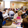 Alexandria High School English teacher Barbara Miller goes over items with students in her AP English Language Composition class on the first day of school in the Alexandria school system.