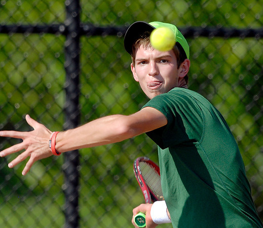Pendleton Heights Graham McMullen returns a shot in his #1 singles match.