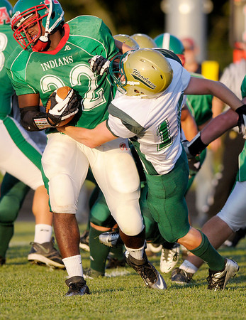 Anderson's Tim Boyd breaks the tackle of Greenwood's Kevin Caraway as the Indians hosted the Woodmen for their season opener on Friday.