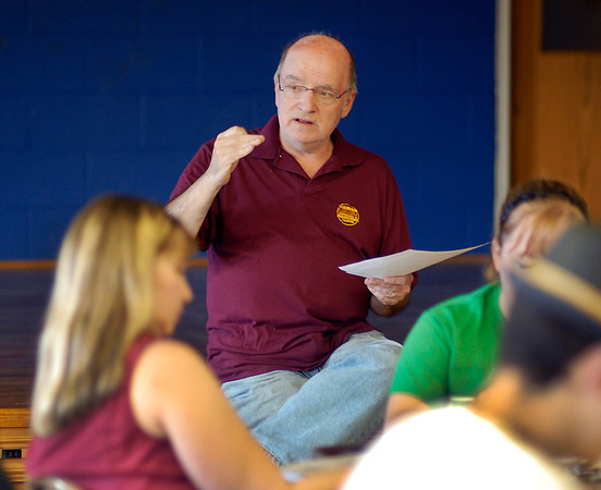"Bill Malone, director of ""Little Shop of Horrors,"" talks with the cast about rehearsal plans at the first group meeting on July 9. Performances of the musical begin Thursday."