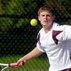 Alexandria's Jake Fox returns a shot in his #1 singles match.