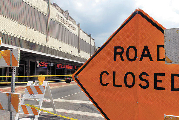 Anderson Street in downtown Elwood is closed due to falling bricks from the facade of the Leeson's building.