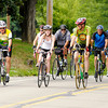 Cyclists travel through Ovid on their way to Pendleton on Tuesday. Madison Park Church of God hosts a bike ride every Tuesday.