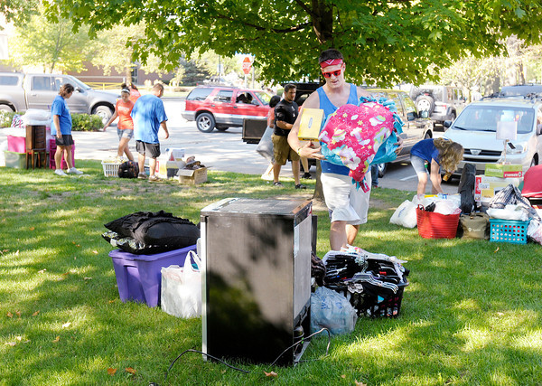 Senior Charlie Holcomb was one of many volunteers helping to move new students into their dorm rooms at Anderson University on Thursday. Classes for the Fall semester start on Tuesday.