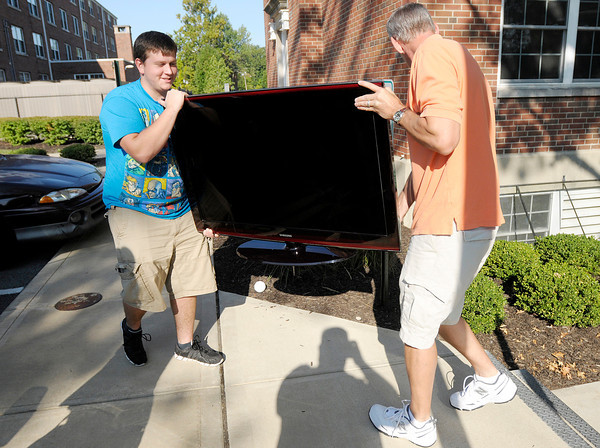 Mark O'Brien and his step father Phil Wellhausen carry a TV into Smith Hall as new students arrived at Anderson University on Thursday. Classes for the Fall semester start on Tuesday.