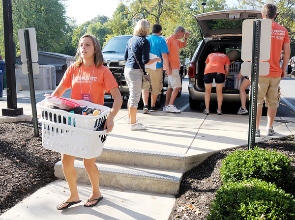 Katie Carlson helps Mark O'Brien move in as new students arrive at Anderson University on Thursday. Classes for the Fall semester start on Tuesday.