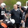 Anderson University head football coach Bobby Ladner works with his defense  during practice Monday.