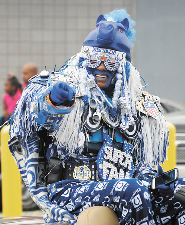 Colts Superfan Michael Hopson of Indianapolis rides in the Black Expo parade on Saturday.