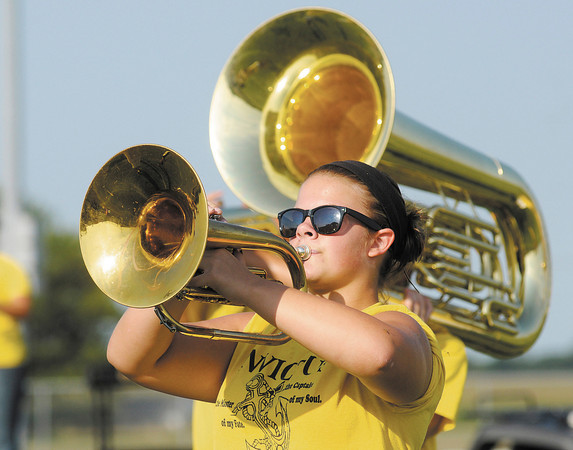 "Annie Gates, 15, plays her mellophone as the Marching Eagles perform their State Fair show ""Invictus"" on Thursday."
