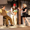 "From right Audrey (Mindy Morton) and Seymour (Tommy Thomas) try to convince Mushnik (Lot Turner) that they should use Seymour's unusual plant Audrey II to bring customers into Mushnik's flower shop in Mainstage's production of the ""Little Shop of Horrors."""