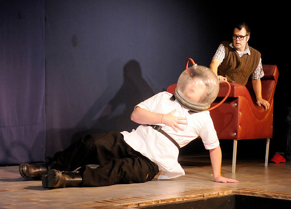 """Seymour (Tommy Thomas) looks on as Orin (Patrick Cramer) asphyxiates in a laughing gas mask in Mainstage's production of the """"Little Shop of Horrors."""""""