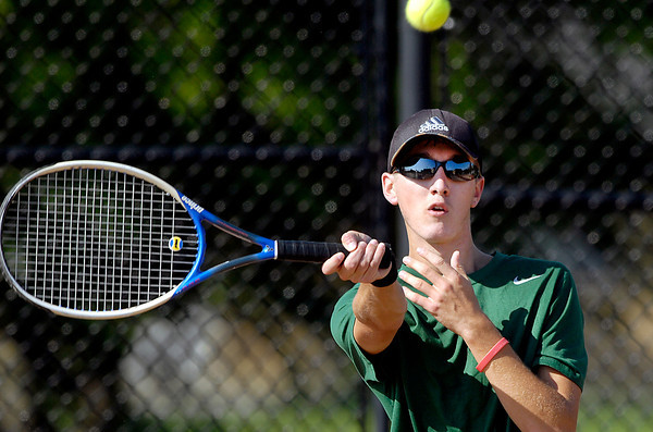 Pendleton Heights Evan Hart returns a shot in his #2 singles match.