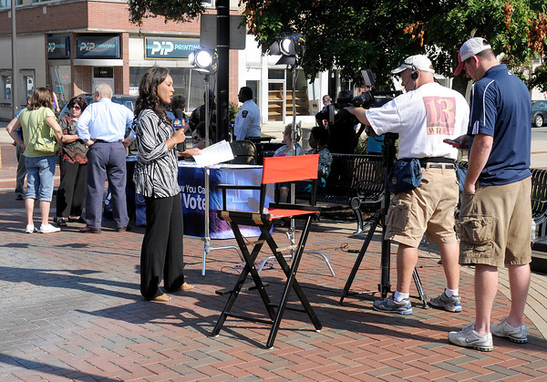 """Anderson native and WTHR news anchor Andrea Morehead broadcasts live from Town Center park on Thursday as part of the station's """"Decision 2012 On the Road"""" series."""