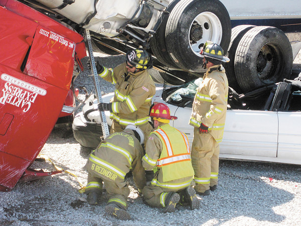 photo by Dani<br /> Firefighters shore up a semi tractor during a training exercise on Saturday.