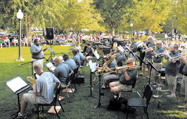 Chris Taylor conducts the Director's Jazz Orchestra at their performance Sunday evening at Music in the Park at Falls Park in Pendleton. Hundreds of music lovers attended the event that also featured the Pendleton Heights Marching Arabians Band.