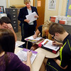 Alexandria High School English teacher Barbara Miller checks her students as they fill out a self-evaluation form on the first day of school.