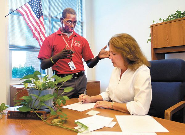 Grerayle Walton, graduate of AHS last year, is back as principal Lucinda McCord's administrative assistant.