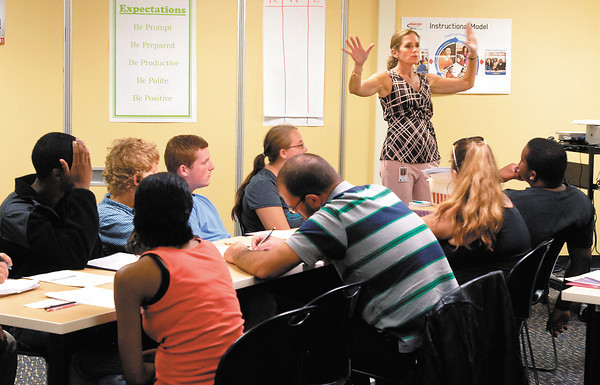 Teacher Gretchen Stullken tells her students what to expect in her Read 180 class at the Excel Center Monday on their first day of classes at the new charter school.