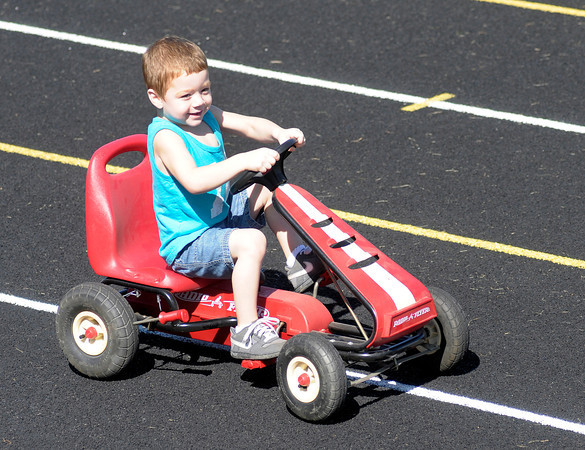 Luke Bigsby wins the 3-year-old division of the Little 400 Pedal Car Race during the Elwood Glass Festival on Saturday.