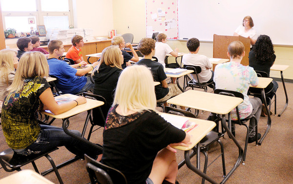 Cheryl Hensley tells the students in her Family Consumer Science class what they can expect in the year ahead during the first day of school at Lapel High School on Wednesday.