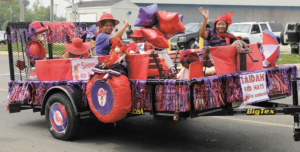 The Saidah Red Hats of Anderson ride down Raible Avenue on their float during the Black Expo parade on Saturday.