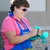 Carrie Nennich maeks balloon animals during a barbecue at the Madison County Community Health Center. Nennich is a dental hygienist at the center.