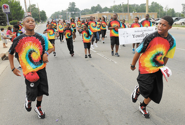 Youth from the Bethesda Missionary Baptist Church march in the Black Expo parade on Saturday.