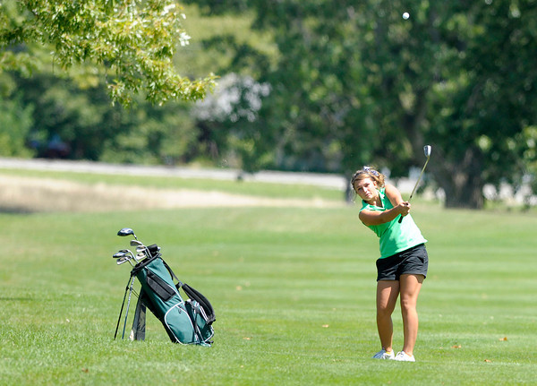 Pendleton Heights' Jordan Dean hits into the 18th green during the County Golf Tournament at the Cattails Golf Club in Elwood on Saturday.