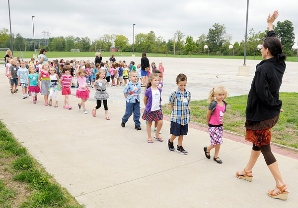 Kindergarten students line up and walk back into school after recess on the first day of school at Maple Ridge Elementary on Tuesday.
