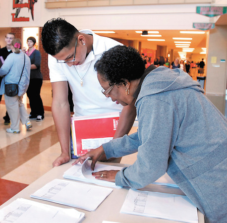 Anderson High School senior Jose Mares gets assistance from Shirley S. Fairer on getting a copy of his class schedule Monday morning on the first day of classes at Anderson High School.