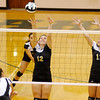 Lapel's Morgan Tarlton (12) and Gabby Cherry (11) try and block an attack by Pendleton Heights Carly Wilson as the Arabians hosted the Bulldogs on Tuesday.