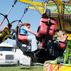 Nicole and John Meyer ride the Tornado during the Elwood Glass Festival on Saturday.
