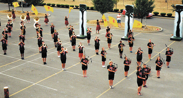 """The Anderson High School Marching Highlander's perform their show, """"Expdition Africa,"""" for parents on Tuesday."""