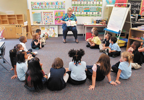 Kindergarten teacher Dixie Amonett reads a book to her class at the Kindergarten Camp being held at Anderson Elementary School.
