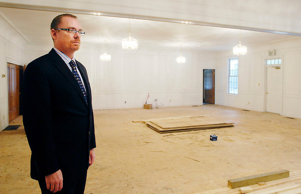 Eddie Beagles, VP of funeral operation for Legacy, looks over the remodeling work that has been done to the old Guilkey Funeral Home.  Legacy is remodeling the interior and plans to open the funeral home this fall.