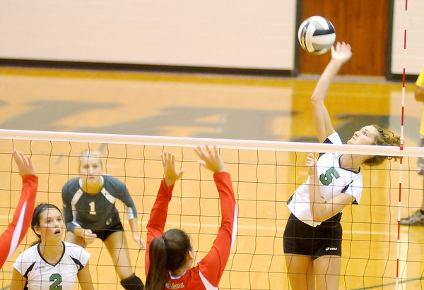 Don Knight/The Herald Bulletin<br /> Pendleton Heights' Carly Wilson attacks the ball as the Arabians hosted the Anderson Indians on Wednesday.