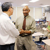 Don Knight/The Herald Bulletin<br /> Anderson Community Schools superintendent Felix Chow talks with history teacher Mike McKenzie as Anderson High School held a Powwow for parents to meet their children's teachers and tour the school on Tuesday.