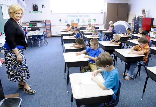 Don Knight/The Herald Bulletin<br /> Cyndy Campbell watches over her first grade students as they complete a worksheet at Indiana Christian Academy on Friday.