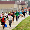Alexandria-Monroe Jr.-Sr. High School students walk from their building to the intermediate school to catch their school bus at the end of school Wednesday.<br /> With the balanced school calendar students started classes July 30th.