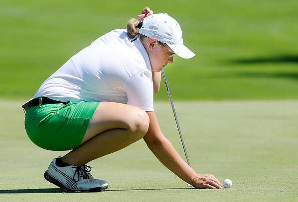 Don Knight/The Herald Bulletin<br /> Pendleton Heights' Emily Tilton places her ball on her ball mark on the 17th green at The Edge during the Girl's County Golf tournament  on Saturday.