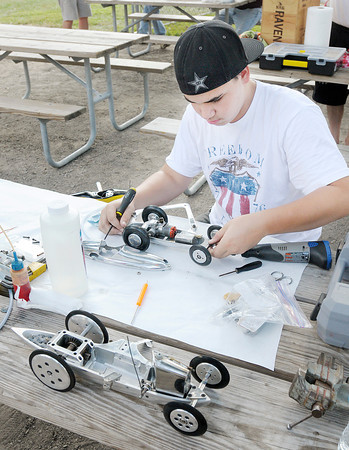 Don Knight/The Herald Bulletin<br /> Nicholas Ellick, 15, from Salem Oregon works on a tether car after practice at Jackson Park on Wednesday. Ellick has been traveling to the American Miniature Racing Car Association Nationals with his grandfather Ed Baynes since he was 11. Anderson has the oldest of three tether tracks still in operation and is hosting Nationals this weekend. Practice was Wednesday and competition will be daily through Saturday.