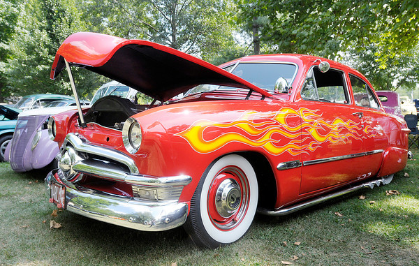Don Knight/The Herald Bulletin<br /> A red hot rod with flames named Marilyn was part of the car show during the Elwood Glass Festival on Saturday.