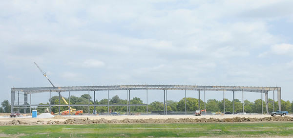Don Knight/The Herald Bulletin<br /> Steal begins to rise into place forming the skeleton of the new Hy-Pro factory in Anderson on Wednesday. Anderson was ranked 64th on Forbes Best Small Places for Business and Careers in the United States.