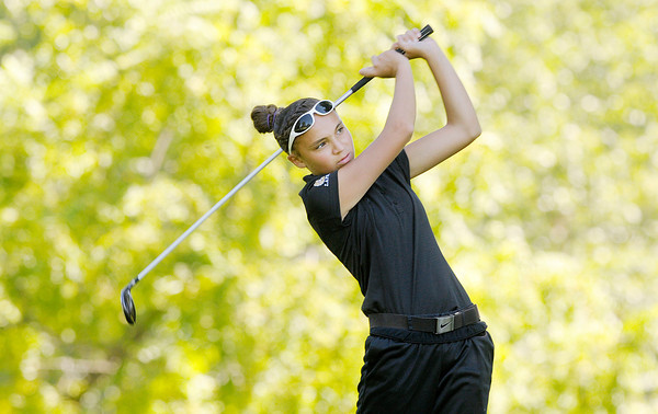 Don Knight/The Herald Bulletin<br /> Lapel's Natalia Campbell watches her tee shot on the par four 17 at The Edge during the Girl's County Golf tournament on Saturday. Campbell carded a 79.