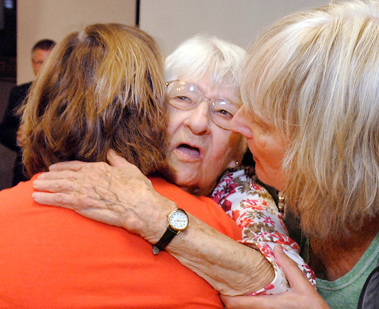 93 year old assault victim Amelia Rudolf gets hugs from daughters Carol Fite and Joanna Hill after she spoke at a news conference Monday after at Anderson Police Department.